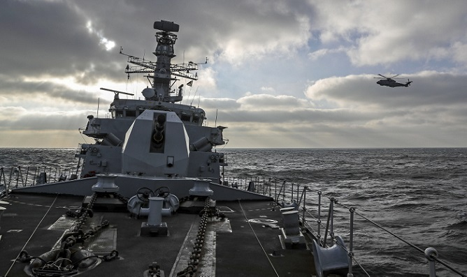 The image shows HMS St Albans during an intercept and escort of Russian Missile Cruiser The Marshall Ustinov in the Channel. It illustrates the types of naval vessels that tpgroup has supported including Type 23 and Type 26.